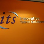 ITS brushed aluminum lobby sign dimensional letterin by JD Sign Co