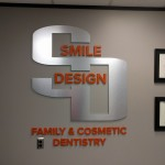 Smile Design dimensional brushed aluminum lobby sign by JD Sign Company