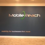 Mobile Reach brushed aluminum dimensional letters lobby sign by JD Sign Co.