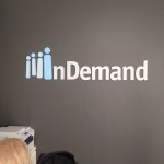 InDemand dimensional brushed aluminum lobby sign by JD Sign Company