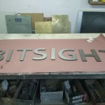 Bitsight dimensional brushed aluminum lobby sign by JD Sign Co