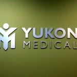 Yukon Medical brushed aluminum dimensional lettering lobby sign by JD Sign Company